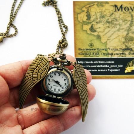Фото часиков Гарри Поттера в руке