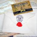 Письмо их Хогвартса и билет.